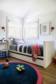 white twin bed with trundle cottage