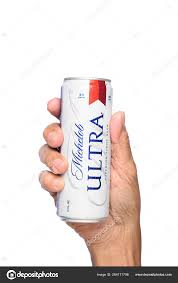 hand holding a can of michelob ultra