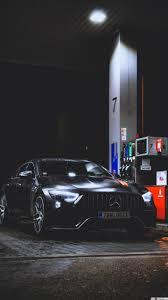 سيارة سوداء مرسيدس بنز في محطة وقود في الليل تنزيل خلفية Hd