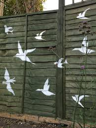 Flying Birds Painted On The Fence Using Homemade Stencils Fence Art Diy Backyard Fence Paint