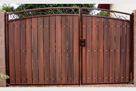 Decorative Arched Rv Gate With Rust And Redwood Wood Gate Driveway Gate Fence Design