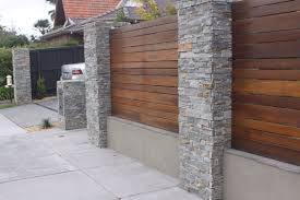 How Good Does It Look As A Feature On A Wood Paling Fence Greystone Fence Outdoor Stone Wall Cladding Wall Cladding Grey Stone Wall