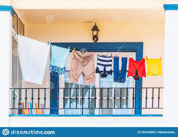 Clothes Hanging On A Washing Line On A Bright Modern Style Blue And White Balcony Stock Photo Image Of Children Blue 152418388