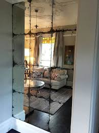 antique mirror glass feature wall in