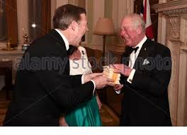 The Prince of Wales with Hilary Russell at a dinner at Mansion House in  London in aid of the Australian bushfire relief and recovery effort hosted  by the Lord Mayor of the