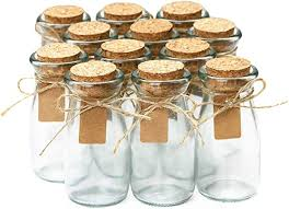 small glass bottles with cork