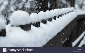 Black And White Image Of A Wooden Fence During Snow Storm That Creates Little Eggs Made Of Snow Maligne Canyon Jasper Canada Stock Photo Alamy
