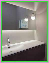 bathroom light over mirror height