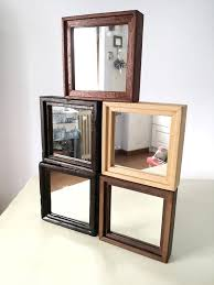 small handcrafted wooden mirror in dark