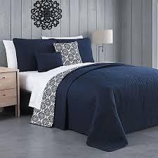 gray bedroom walls blue quilt bedding