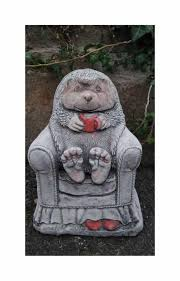hedgehog in chair garden ornaments by