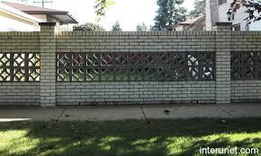 brick fence with decorative concrete