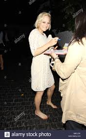 West Hollywood, CA - Adelaide Clemens was in a playful mood after a fun  night at the 'Rectify' Season 2 Premiere afterparty. The 24-year-old  actress ditched her uncomfortable high heels and opted