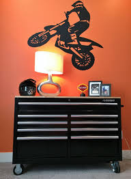 Finishing Up Bubba S Room Since He Rides A Ktm We Had To Go With A Ktm Orange Accent Wall And Of Course To Dirt Bike Bedroom Bike Room Car Themed Bedrooms