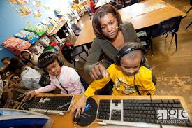 Detroit, Michigan - First grade teacher Ivy Bailey teaches computers at  MacDowell Elementary School, Stock Photo, Picture And Rights Managed Image.  Pic. X2J-1065240 | agefotostock