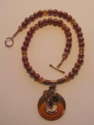 making a swarovski disc pendant necklace