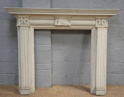 painted carved wooden fire surround