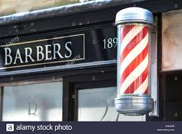Traditional barber's pole outside a shop in central London Stock ...