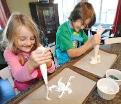 Ivy Johnston, 6, and brother Kade, 8, creating meringue spooky Halloween  treats