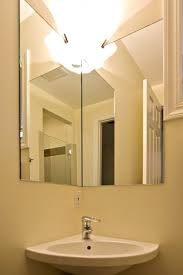 corner sink and corner mirror in small