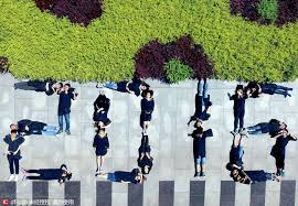 students pose for special group photos
