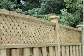 How To Add Privacy Lattice To An Existing Fence Hunker Lattice Fence Fence Toppers Backyard Fences