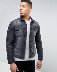 denim jacket with rip repair patches