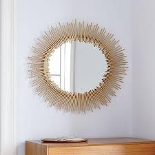 round starburst gold wall mirror