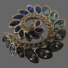 st john rhinestone brooch blue swirl