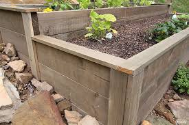 an organic raised bed on a sloped yard