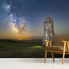 lighthouse next to the milky way mural