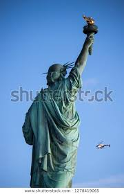 liberty facing blue sky stock photo