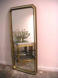faceted hollywood regency style mirror