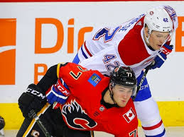 Flames sign Albertans Brandon Davidson, Byron Froese to two-way deals    Calgary Sun