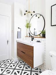 round mirror and single sink cabinet