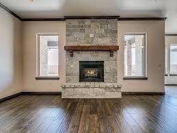 stone fireplace with barnwood beam