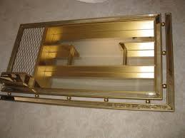 gold mirrored shadow box shelf unit