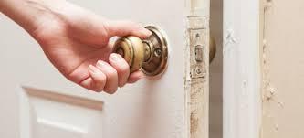 unlocking a bedroom door in an