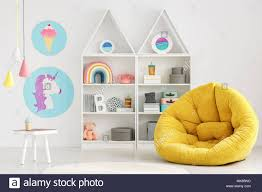 Yellow Pouf In Colorful Scandi Kid S Room Interior With Posters And Lamps Above White Table Stock Photo Alamy