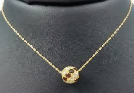 pendant set of 18 kt yellow gold