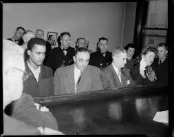 Shooting suspect Lawrence Robinson, detective Clem Bartirome, detective  inspector Adam Geisler, and shooting victim Janet Mackrell with hand  raised, standing at judge's bench in Morals Court, Allegheny County  Courthouse | CMOA Collection