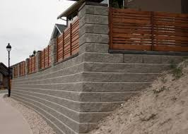 wood fence concrete blocks retaining wall