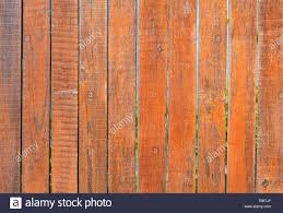 The Aged Old Gray Wooden Fence Is Painted With Orange Paint Close Up Stock Photo Alamy
