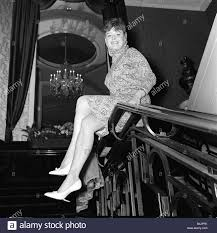 Janet Munro actress sitting on banisters at a rehearsal for the Royal Stock  Photo - Alamy