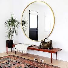 11 ways to style large round mirrors