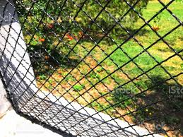 Black Chain Link Metal Fence In White Wall Frame Stock Photo Download Image Now Istock