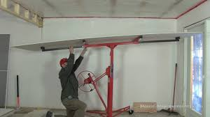 how to use a drywall lift you