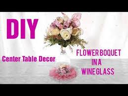 diy flower bouquet in a wine glass as