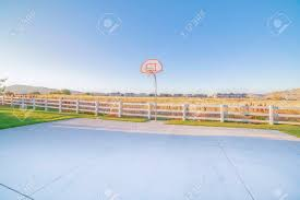 Empty All Weather Exterior Basketball Court Surrounded By White Stock Photo Picture And Royalty Free Image Image 137140766