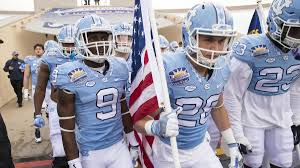 North Carolina suspends 13 football ...